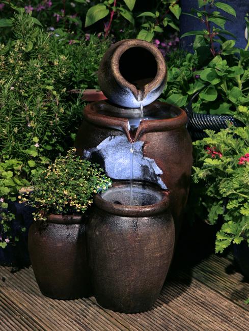 Fuente de Agua Vasijas Oscuras de Miel con Luces y Maceta - 50 cm de ...